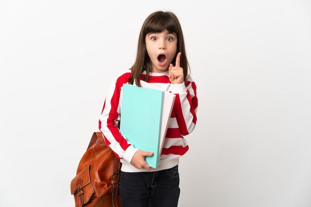 Маленькая девочка студент, изолированные на белом фоне, намереваясь реализовать решение, подняв палец вверх