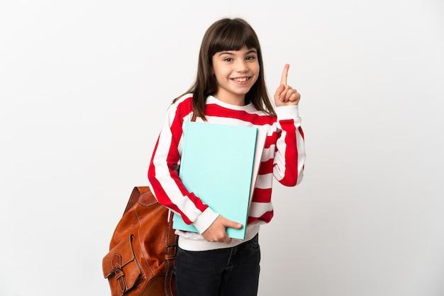 Маленькая девочка студент, изолированные на белом фоне, показывая и поднимая палец в знак лучших