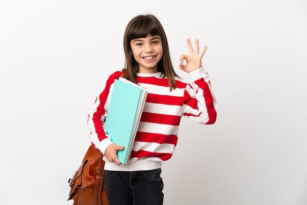 손가락으로 확인 표시를 보여주는 흰색 배경에 고립 된 어린 학생 소녀