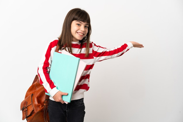 Little student girl isolated on white background extending hands to the side for inviting to come