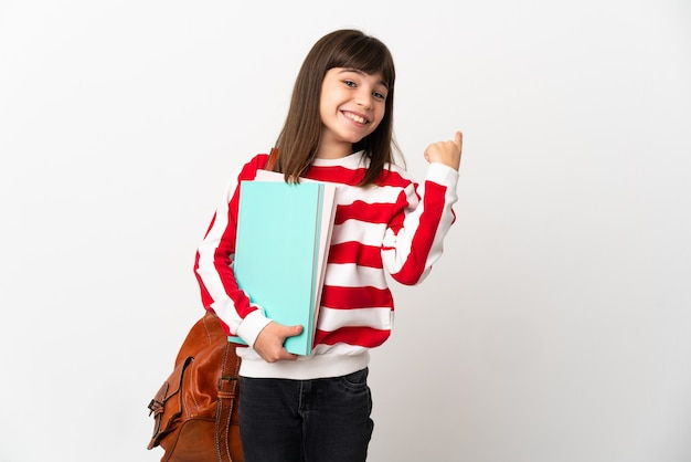 Little student girl isolated on white background intending to realizes the solution while lifting a finger up