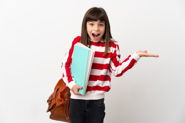 Little student girl isolated on white background with shocked facial expression