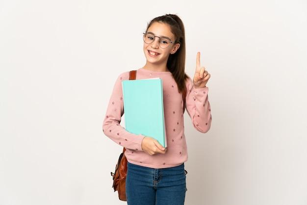 Маленькая девочка-студентка на изолированном фоне показывает и поднимает палец в знак лучших