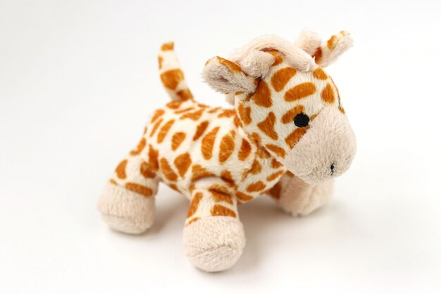 Little stuffed giraffe plush isolated