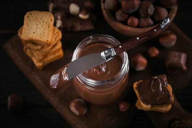 Little toasts with sweet hazelnut chocolate spread for breakfast.