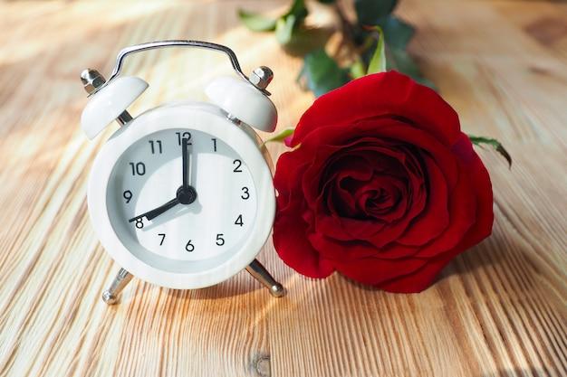 Little white alarm clock . beautiful sun rays. good morning concept.