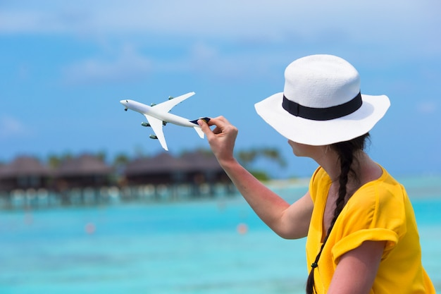Little white toy airplane in woman hands