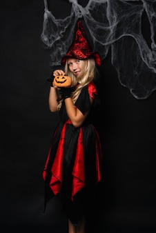 Little witch with jack-o-lantern