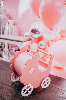 Little wooden baby stroller toy at a baby shower party
