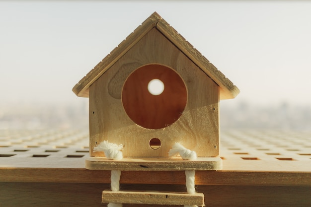 Little wooden house for small pet in concept of buying dream house.