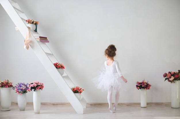 Little young ballerina in a playful mood