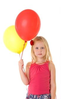 分離された風船を持つ少女