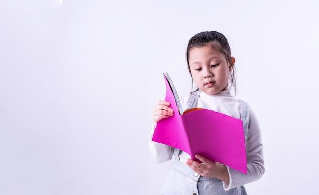 The littler girl reading book