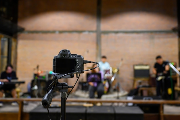 Live broadcast via video camera shoot musicians playing concerts without anyone watching at the concert. Premium Photo