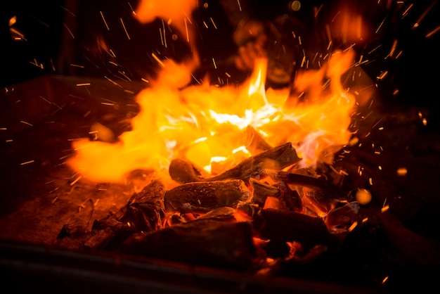 Live burning coals with fire and sparks