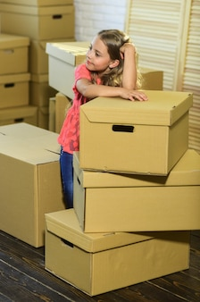 Live like you want happy child cardboard box happy little girl purchase of new habitation moving
