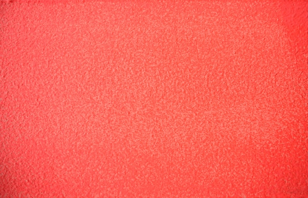 Living coral color painted concrete wall texture backgrond