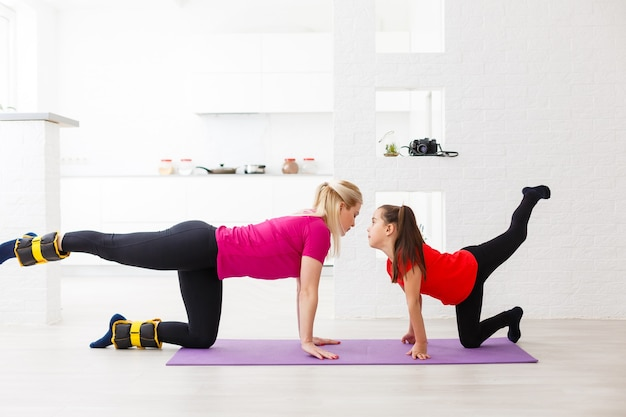 Living room fitness workout girl doing exercises at home. young woman training muscles, healthy lifestyle without going to the gym.