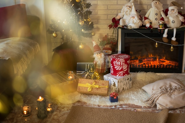 Living room of the house with christmas decorations and gifts under the christmas tree.