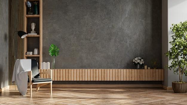 거실 내부에는 콘크리트 벽이있는 시멘트 방에 tv 및 안락 의자가 있습니다.