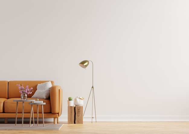 흰색 벽 배경에 가죽 소파와 따뜻한 색조의 거실 인테리어 벽. 3d 렌더링
