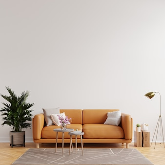 Living room interior wall mockup in warm tones with leather sofa on white wall background.3d rendering