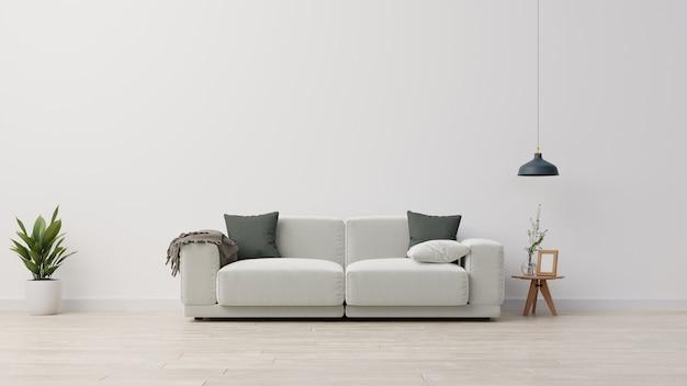 빈 흰색 벽 배경에 꽃병에 회색 벨벳 소파, 회색 베개, 격자 무늬 및 녹색 식물 분기와 거실 인테리어 벽.