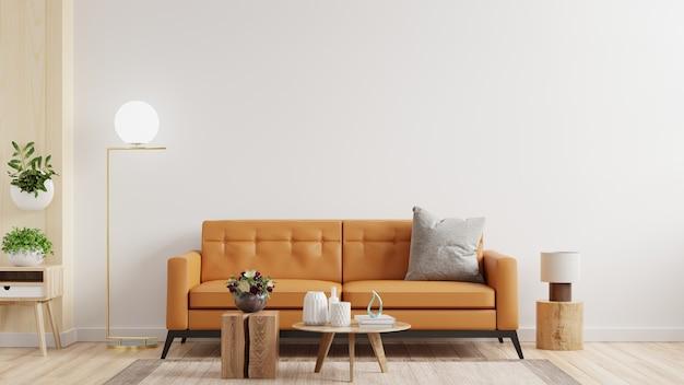 Интерьерная стена гостиной в теплых тонах и кожаный диван на белой стене