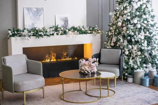 Living room interior with fireplace and chrismas tree