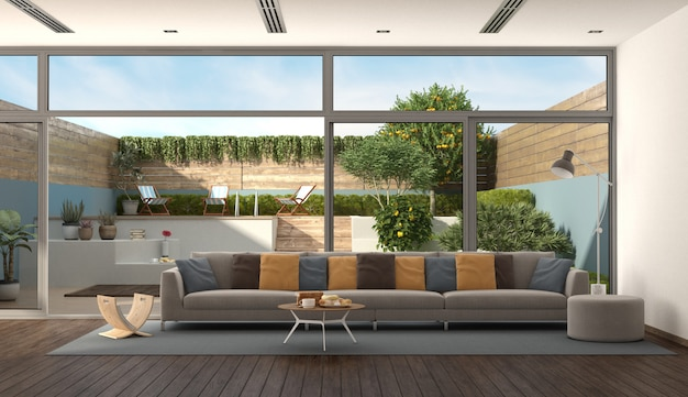 Living room of a modern villa with garden on background