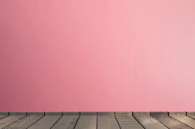 Living room in pink tones wall interior parquet wood floor with copy space