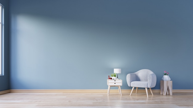 Living room with armchair with lamp on stump, wood flooring and dark blue wall