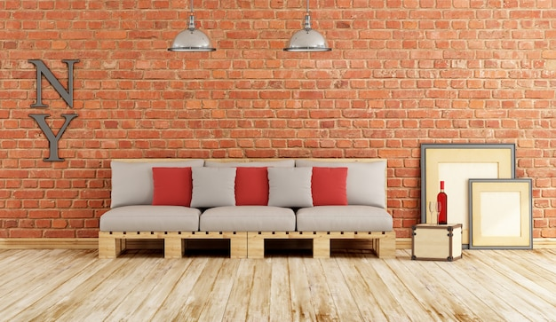 Living room with pallet sofa against brickwall