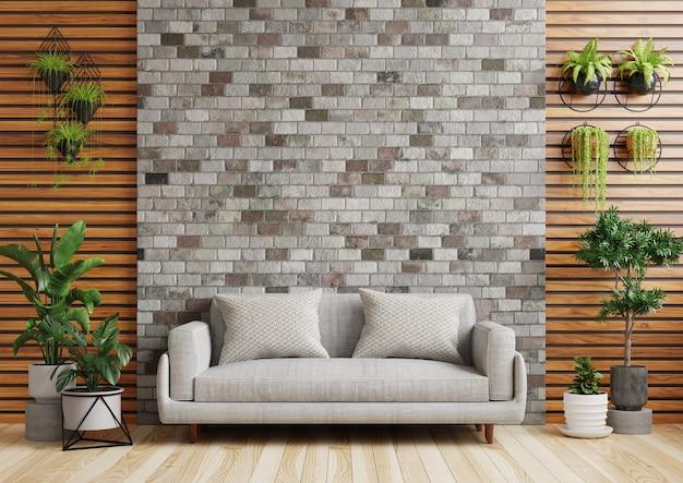 ソファ、植木鉢、レンガの壁のあるリビングルーム