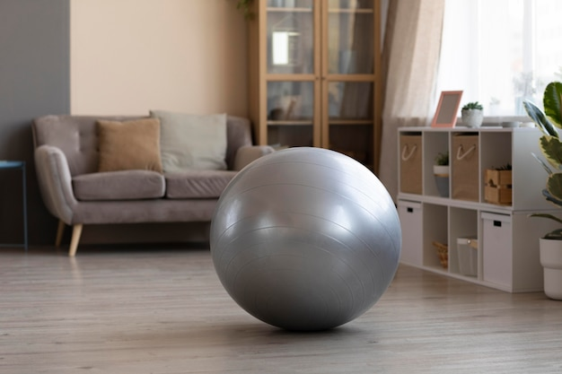 Living room with swiss ball on the floor