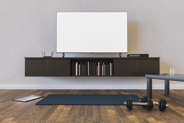 Living room with tv mock-up, laptop and mat with dumbbells on the floor