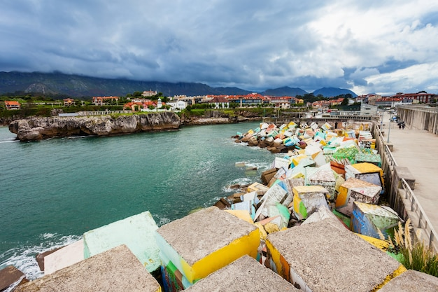 Llanes, spain - september 25, 2017: memory cubes art monument at the pier in llanes city, asturias province in northern spain