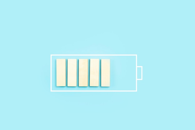 Load battery charge icon background wooden blocks as a charging process high quality photo