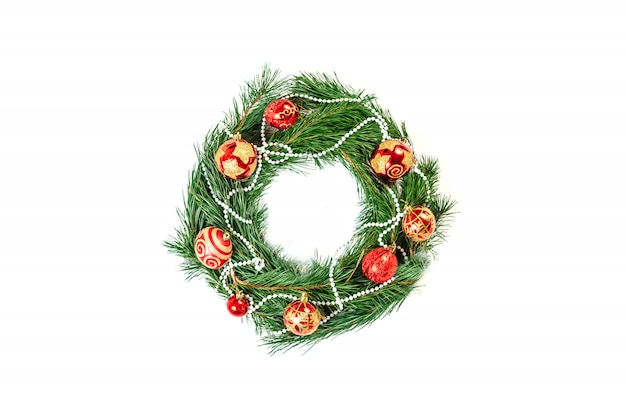 Loaded christmas wreath isolated on white