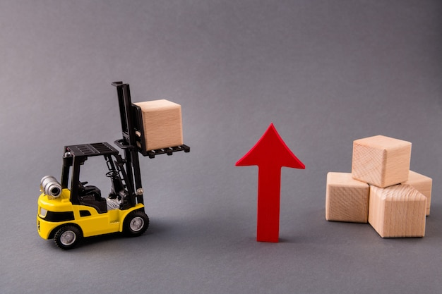 Loader deliver wooden cube arrow pointing up commerce rise