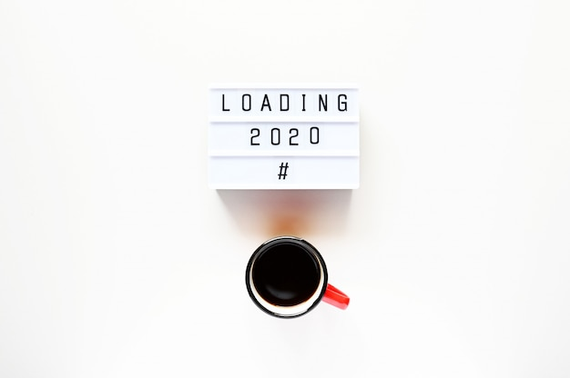 Loading 2020 with cup of coffee