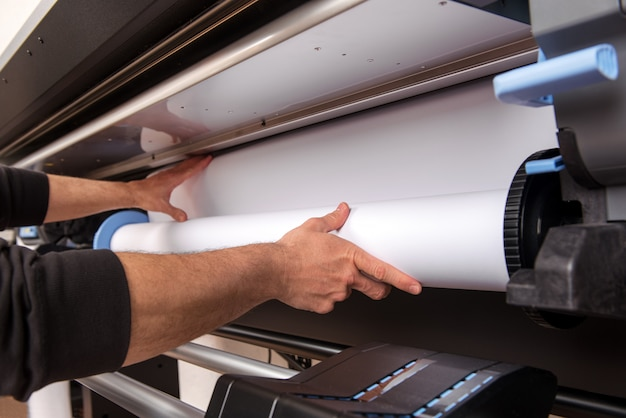 Loading roll of paper on printer