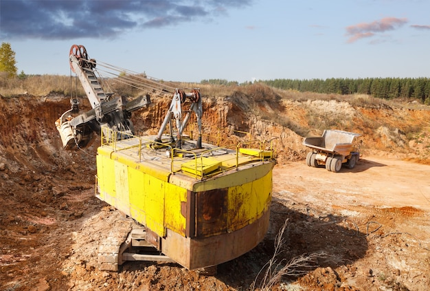 Loading of soil in the quarry excavator