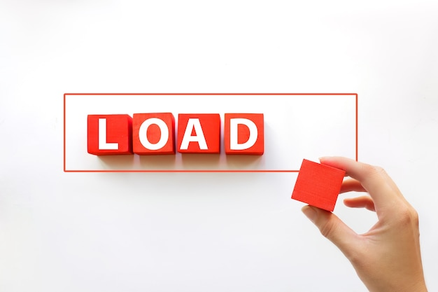 Loading with hand putting red cube in progress bar. loading time or process concept.
