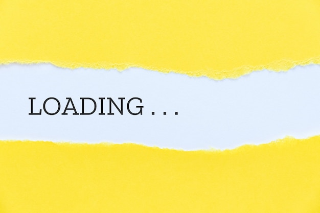 Loading word typed on yellow paper background