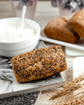 Loaf of bread topped with poppy and sesame seeds