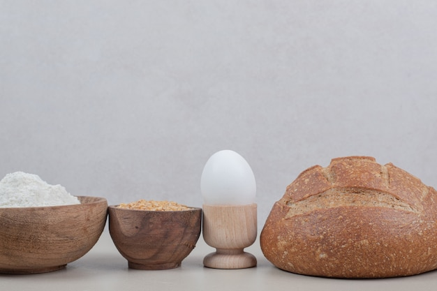 Loaf of bread with boiled egg and oat grains. high quality photo