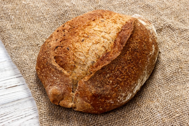 Loaf of bread on wooden, food closeup