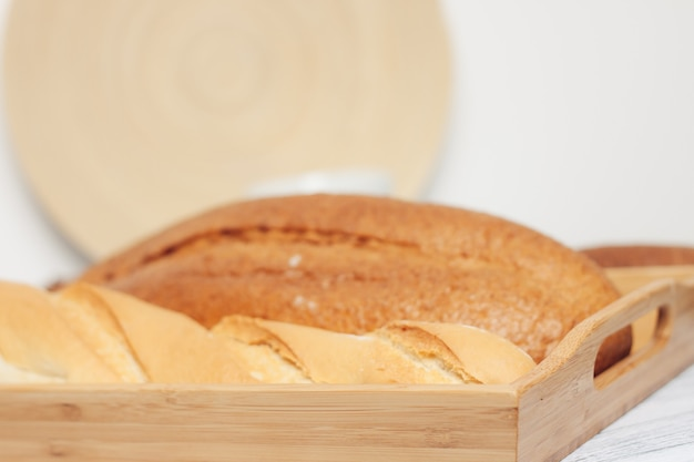 Loaf in breadbox fresh baked goods food ration kitchen freshness. high quality photo