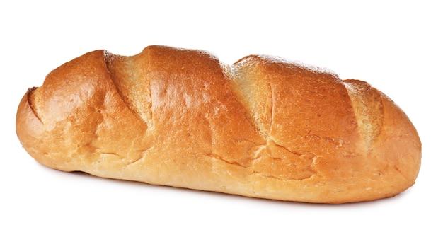 Буханка свежего вкусного хлеба на белом